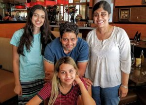 Sam and Viji with their two daughters, Anika and Maya.